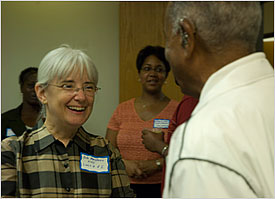 Kathleen MacQueen speaks with a Durham community member.